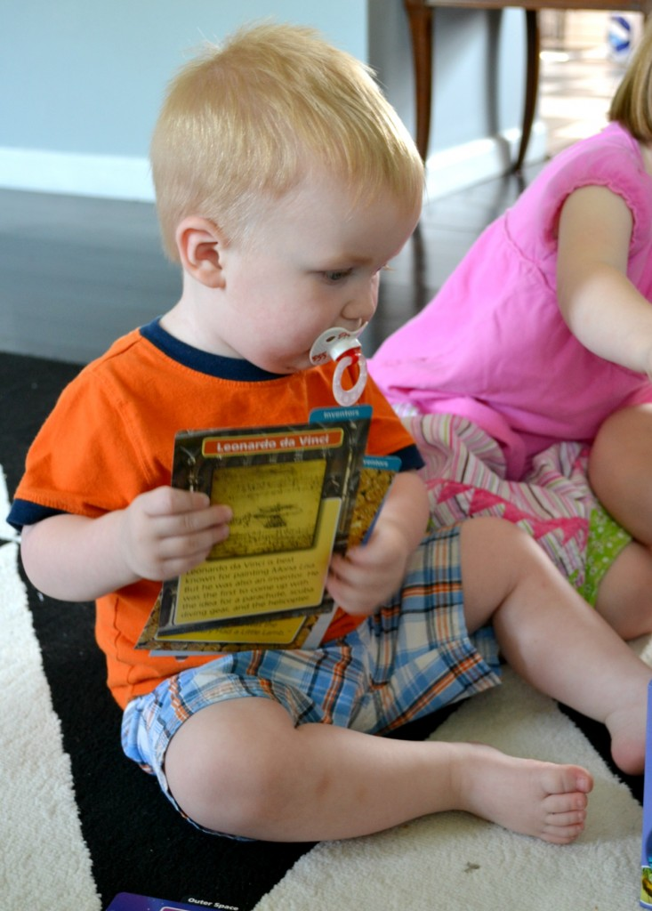 toddler with flashcards